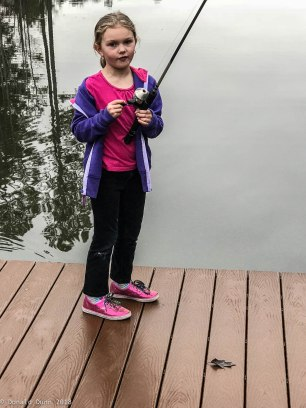 Harper fishing, just before a tumble into the lake